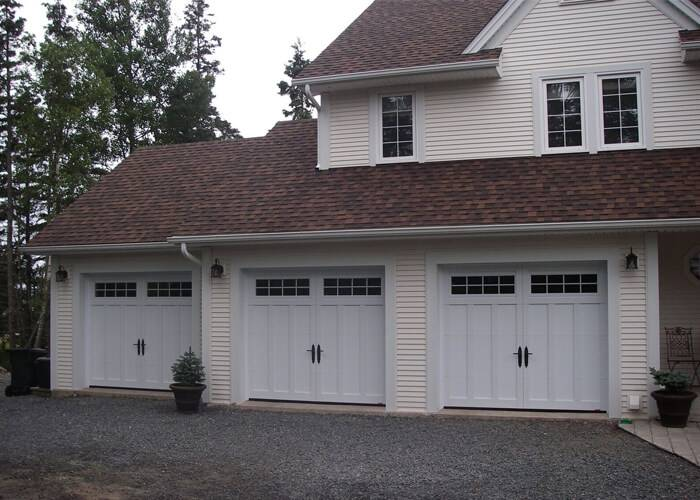 Eastman E-13, 9' x 7', Ice White doors and overlays, 8 lite Orion windows
