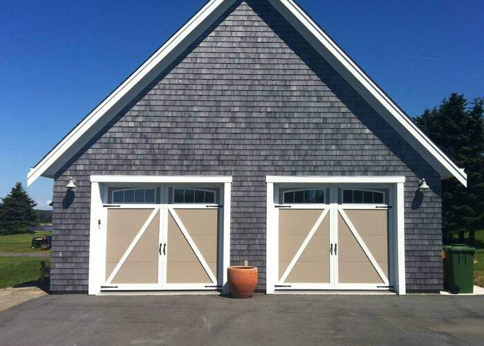 Eastman E-22, 9' x 7', Claystone doors and Ice White overlays, Arch overlay with 4 vetical lite Panoramic windows